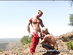 Athletic blondes suck dick on a hike tubes
