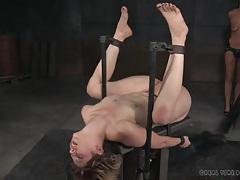 Bound chick gets a hard flogging on her naked parts tubes