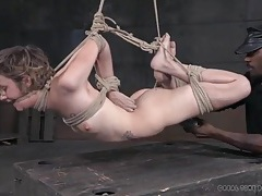 Skinny girl in a rope bondage suspension suffers abuse tubes