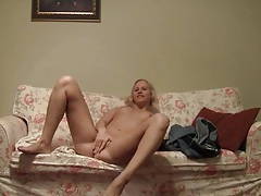 Sweet blonde sets up her camera and strips solo tubes