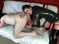 Shiny latex mistress fucks him anally with a strapon tubes