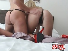 Girls in sexy red high heels kiss and fuck toys together tubes