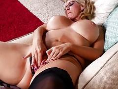 Old hottie rubs her enflamed pink pussy tubes