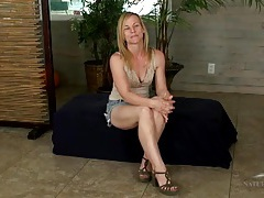 Playful blonde milf spreads her legs and flashes tubes