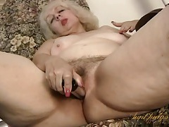 Granny with a nice bush fucks her toy tubes