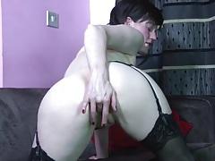Cute solo milf in stockings rubs her wet cunt tubes