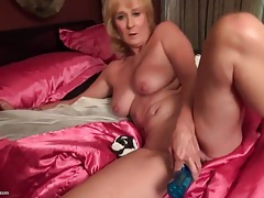Sexy shaved mature cunt fucked by a toy tubes