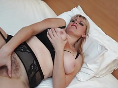 Pierced clit milf fingers her hairy pussy tubes