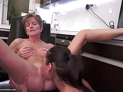 Teen licks a mature lesbian in the office tubes