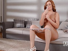 Redhead sensually sucks and fucks her dildo tubes