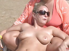 Girlfriends at the beach have big tits in bikinis tubes