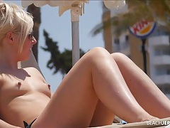 Young blonde on the topless beach has sexy small tits tubes