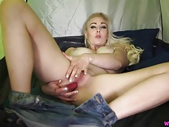 Cute blonde in a tent talks dirty and fucks a toy tubes
