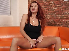 Hot upskirt from a big tits redhead tubes