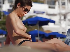 Small perky tits cutie is spied on at a beach tubes