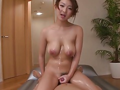 Japanese chick coated in oil for a titjob tubes