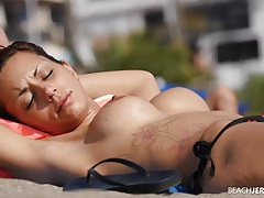 Perky implants on a skinny beauty in the sand tubes