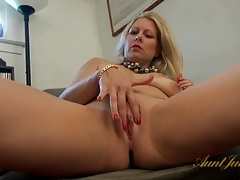 Her lovely milf pussy is shaved clean as she plays tubes