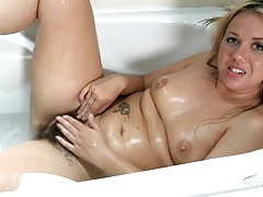 Hairy mom pussy needs to get clean in the bathtub tubes