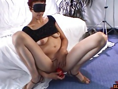 Blindfolded redhead toys her shaved pussy tubes
