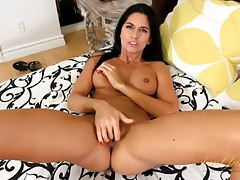 Gorgeous tanned milf is soaking wet as she plays tubes