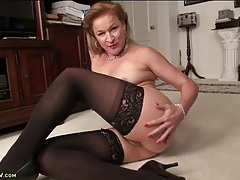 Mature lady in stockings has a hairy bush tubes