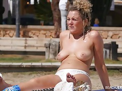 Curly hair milf with her tits out as she tans tubes