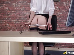 Secretary in a sheer blouse and hot stockings tubes